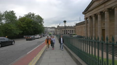 Walking and driving by the Scottish National Gallery, Edinburgh Stock Footage