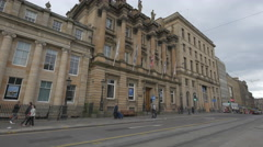 People walking by Bank of Scotland on Saint Andrew Square, Edinburgh - stock footage