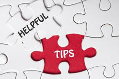 Helpful Tips. Missing Piece Jigsaw Puzzle with word Stock Photos