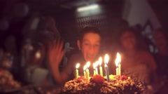 4K Happy Cute Boy Blowing at Cake at Birthday Party Stock Footage