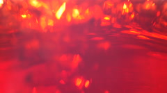 Pours juice, a beautiful ruby color the background. Stock Footage