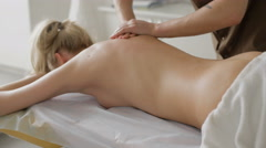Client relaxing in massage at the spa Stock Footage