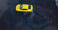 Top view of the golden car drifting on the road. Сar makes a few laps. Stock Footage