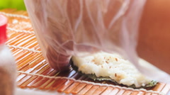 Closeup Hands Roll Sushi Ingredients on Wooden Desk - stock footage