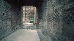 Suggestive ancient roman passage dolly frontal Stock Footage