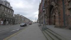 Traffic on Queen street, near the Scottish National Portrait Gallery, Edinburgh Stock Footage
