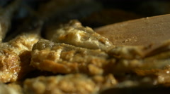 Fry small fish in a frying pan Stock Footage