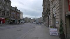 Walking on St Andrew street, near fast food restaurants, Edinburgh Stock Footage