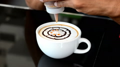 Stock Video Footage of Barista decorate top surface of latte art coffee