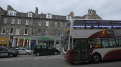 Driving a bus on Hanover street, near the Thomas Cook travel agency, Edinburgh Stock Footage