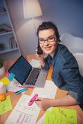 Beautiful young woman is using modern technology - stock photo