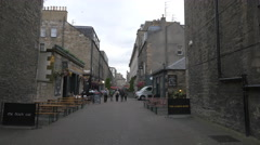 Walking and relaxing at the pubs on Rose street, Edinburgh - stock footage