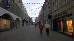 Walking on Rose street, passing by Debenhams and Verve clothing store, Edinburgh Stock Footage