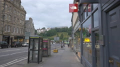 Driving cars on Frederick street, passing by The North Face, Edinburgh Stock Footage