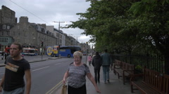 Driving buses on Princes street cross to Frederick street in Edinburgh - stock footage