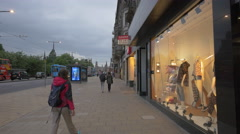 Walking on Princes street, passing by Levi Strauss store, Edinburgh Stock Footage