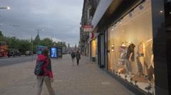 Walking on Princes street, passing by Levi Strauss store, Edinburgh Stock Footage