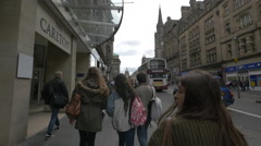 People walking by the Carlton Hotel in Edinburgh Stock Footage