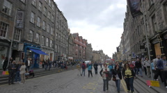 Tourists and locals walking on Lawnmarket in Edinburgh Stock Footage