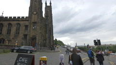 People walking near the New College in Edinburgh Stock Footage