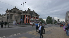 Driving on Princes street, in front of the Royal Scottish Academy, Edinburgh Stock Footage