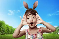 Cute little child girl wearing bunny ears Stock Photos