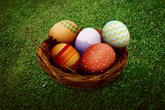 Colorful eggs in one nest Stock Illustration