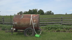 Tracking shot of an old water sprayer trailer. Stock Footage