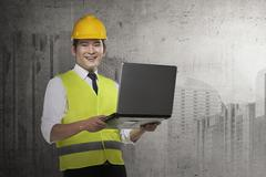 Asian engineer wearing safety vest Stock Photos