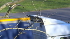 Nude branches and traffic - cars on highway - zoom in - stock footage