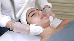 Cosmetic facial treatment with gloves Stock Footage