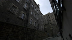 Walking by the old buildings on Old Fishmarket Close in Edinburgh - stock footage