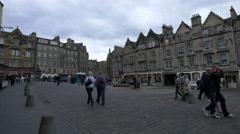 People walking on Grassmarket Square in Edinburgh Stock Footage