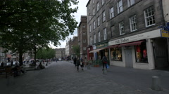 Walking and relaxing near Bill Baber store in Grassmarket, Edinburgh Stock Footage