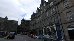 Driving and walking in the Grassmarket Square, on a cloudy day in Edinburgh Stock Footage
