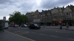 People waiting for the bus on the street in Grassmarket Square in Edinburgh Stock Footage