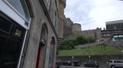 Edinburgh Castle on Castle Rock seen from the Grassmarket Square, Edinburgh Stock Footage