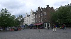 Walking near Made in Italy Pizzeria, in Grassmarket Square, Edinburgh Stock Footage