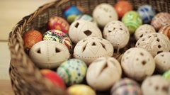 Easter eggs rolling on green background - stock footage