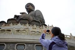 Woman taking photograph of tian tan buddha, hong kong, china Stock Photos