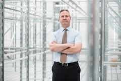 Man with arms folded in empty warehouse, portrait Stock Photos