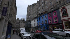 Walking by Long Tall Sally and other stores on Victoria street, Edinburgh Stock Footage