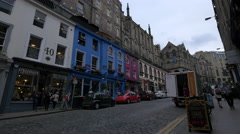 Walking and driving by the stores on Victoria street, Edinburgh Stock Footage