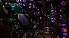Light moves around the circuit board and create long moving shadows. Macro Stock Footage