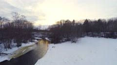 Winter landscape. Sunset at river and forest. Aerial footage. Stock Footage