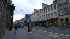 People walking on South Bridge, near Tesco Express store in Edinburgh Stock Footage