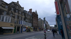 Walking and driving on Nicolson street, near 1505 Cafe in Edinburgh Stock Footage