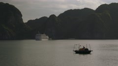 Gloomy seascape with small traditional asian boat Stock Footage