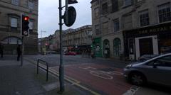 Walking on Infirmary street cross to South Bridge, Edinburgh Stock Footage