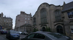Cars parked on Infirmary Street, near the Lady Yester's Church, Edinburgh Stock Footage